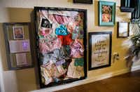 <p>A shadow box containing items belonging to Anistyn Ragan hangs on the living room wall of the family home in Lewisville.</p>(Ashley Landis/Staff Photographer)