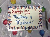 A birthday cake for Medicare and Medicaid sits on a table at the meeting of the Texas Alliance for Retired Americans on Wednesday.(Nicole Cobler/Staff)
