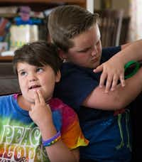 Marilyn Morrison, 9, makes a face alongside her playful brother Miles, 10.(Ryan Michalesko/Staff Photographer)