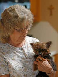 Jackie Merrell holds her 15-year-old dog at her home in Cedar Hill. Tammy Miller, manager of Tri-City Animal Shelter, makes in-home visits to senior residents with pets and provides their care.(Jae S. Lee/Staff Photographer)