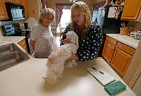 Tammy Miller (right), manager of Tri-City Animal Shelter, checks Jackie Merrell's 8-year-old dog Molly at Merrell's home in Cedar Hill.(Jae S. Lee/Staff Photographer)