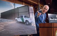 Senate Majority Whip John Cornyn of Texas points to a poster with an image of a barrier on the Texas-Mexico border as he talks to reporters about border security on Thursday, Aug. 3, 2017, on Capitol Hill.(J. Scott Applewhite/The Associated Press)