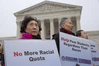 Guixue Zhou of North Potomac, Md., left, and others, protests against racial quotas outside the Supreme Court in Washington on  Dec. 9, 2015, as the court hears oral arguments in the Fisher v. University of Texas at Austin affirmative action case. (AP Photo/Jacquelyn Martin)(Jacquelyn Martin/AP)
