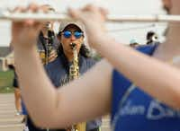 Keller High School Indian Band saxophone player Amanda Bernardi, 16, is framed by a fellow band member during practice Wednesday morning. The band has been  selected to perform in the 2018 Macy's Thanksgiving Day Parade.(Ron Baselice/Staff Photographer)