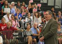 Congressman Michael Burgess talks with concerned residents during a town hall meeting at Braswell High School in Little Elm, Texas on Thursday, August 3, 2017.(Louis DeLuca/Staff Photographer)