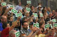 The crowd lets their feelings be known at a town hall meeting with Congressman Michael Burgess at Braswell High School in Little Elm, Texas on Thursday, August 3, 2017.(Louis DeLuca/Staff Photographer)