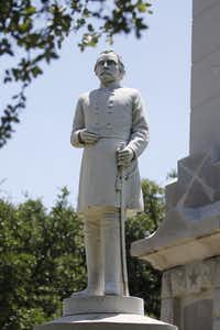 An Albert S. Johnston statue stands outside a Confederate memorial in Pioneer Park Cemetery in Dallas on Wednesday, June, 24, 2015. (Michael Reaves/The Dallas Morning News)(Michael Reaves/Staff Photographer)