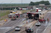 A view from the University of North Texas pedestrian bridge over Interstate 35E toward the junction of I-35E and Interstate 35W shows a burned 18-wheeler after it crashed and caught fire Tuesday in Denton.(Jeff Woo/Denton Record-Chronicle)