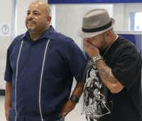 Anthony Wiggs (left) and Raymond Ramirez wait to meet their biological mother, Elsie Ramirez, for the first time at DFW Airport.(David Woo/Staff Photographer)