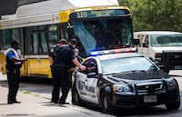DART officers work near a DART police car on Thursday, August 3, 2017 near the West End DART station in downtown Dallas. (Ashley Landis/Staff Photographer)