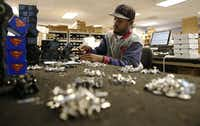 Brandon Yeates fills orders of cufflinks in the shipping and receiving at Cufflinks.com on Friday, November 7, 2014 in Dallas, Texas. (David Woo/The Dallas Morning News)(David Woo/Staff Photographer)