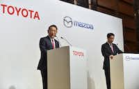 Toyota Motor Corporation President Akio Toyoda (L) answers questions as Mazda Motor Corporation President and CEO Masamichi Kogai (R) looks on during their joint press conference at a hotel in Tokyo on August 4, 2017. (Kazuhiro Nogi/AFP/Getty Images)
