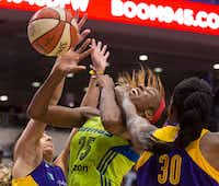 Dallas Wings forward Glory Johnson (25) takes a hand to the chin as she grapples for a rebound with Los Angeles Sparks guard Sydney Wiese (left) and forward Nneka Ogwumike (30) during a WNBA match-up between the Dallas Wings and the Los Angeles Sparks on Sunday, August 6, 2017, at College Park Center, in Arlington, Texas. (Ryan Michalesko/The Dallas Morning News)