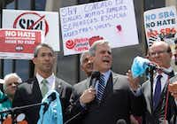 "Austin Mayor Steve Adler (center) said Sen. John Cornyn's new border security legislation — and its focus on sanctuary cities — would force his city to choose between ""safety and much-needed funding."" (Eric Gay/The Associated Press)"