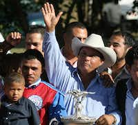 In this photo taken Sept. 6, 2010, owner Jose Trevino Morales, center, acknowledges the crowd after Mr. Piloto won the All American Futurity horse race at Ruidoso Downs, N.M.(Rudy Gutierrez/(DMN file/AP))