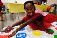 Lailah Burton, 10, plays twister with her mom during the Let's Play Gaming Expo at the Irving Convention Center in Irving, Texas on Saturday, August 5, 2017. (Tailyr Irvine/The Dallas Morning News)(Tailyr Irvine/Staff Photographer)