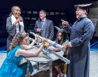 Renee Jones, left, plays a rabbi and David Lugo, a lawyer. Seated are Cora Grace Winstead as Ariadne, Darren McElroy as the Minotaur and Randy Pearlman as a priest in the regional premiere of <i>The Minotaur</i> at Theatre Three in Dallas.(Ron Heflin/Special Contributor)