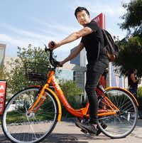 Euwyn Poon, president of Spin, a new bike-share company in Dallas, took a spin around Klyde Warren Park on Friday.(Ron Baselice/Staff Photographer)