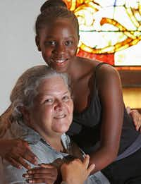 """<p>Dolena Westergard with a woman she mentored,Fausta Twizerimana, at Grace United Methodist Churc<span style=""""font-size: 1em; background-color: transparent;"""">h</span></p>(2015 File Photo/Staff)"""