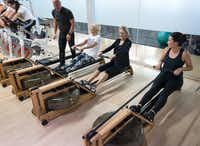 Equinox Group fitness manager Will Amason (top left) works with rowers at the Move for Minds event.(Bruno/)