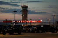 The air traffic control tower and parking lot at Love Field. (Smiley N. Pool/Staff Photographer)