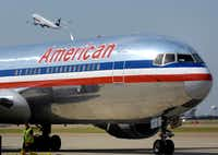 An American Airlines jet at Dallas-Fort Worth International Airport in 2013.(Max Faulkner/Fort Worth Star-Telegram)