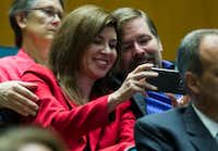 Former Dallas City Council member Angela Hunt, the leading voice against the Trinity River toll road, took a selfie with former elections administrator Brooks Love after the council voted to kill the road Wednesday.(Ashley Landis/Staff Photographer)