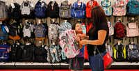 Back-to-School shoppers Tayde Salas, 9, pleads for her mother Cathy Salas to buy a pink backpack at Target as they get a head start on school supplies in Dallas, Wednesday, August 9, 2017. It's tax-free weekend in Texas starting Friday. (Tom Fox/The Dallas Morning News)(Tom Fox/Staff Photographer)