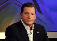 """In this July 22, 2015, file photo, co-host Eric Bolling appears on """"The Five"""" television program, on the Fox News Channel, in New York. Bolling is suing the reporter who broke the story that he allegedly sent lewd text messages to colleagues. Bolling filed a $50 million defamation lawsuit Wednesday against Yashar Ali, a Huffington Post contributing writer.(Richard Drew/AP)"""