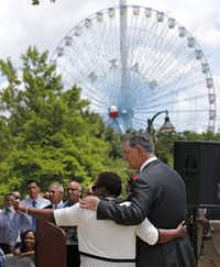 Dallas Mayor Mike Rawlings (right) and the Dallas City Council's Carolyn R. Davis join forces to announce plans to enhance the aesthetic appeal and improve the economic viability of businesses located in the South Dallas/Fair Park area,  at a press conference at Fair Park in Dallas,Texas on Tuesday, June 10, 2014.(Louis DeLuca/Staff Photographer)