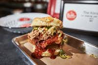 "<p><span style=""font-size: 1em; background-color: transparent;"">Hot Box in Tokyo dish of fried chicken, gochujang glaze, pulled pork and Asian slaw, during a pop-up brunch held by Hot Box Biscuit Club at Tokyo Cafe.</span></p>(Brandon Wade/Special Contributor)"