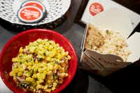 Chicken fried rice with Miso Corny at pop-up brunch held by Hot Box Biscuits Club at Tokyo Cafe.(Brandon Wade/Special Contributor)