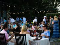 Guests dine outdoors during a supper club dinner at Magdalena's  in Fort Worth.(Tailyr Irvine/Staff Photographer)