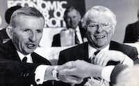 December 9, 1986 - H. Ross Perot (left) and General Motors Chairman Roger B. Smith are seen at a luncheon sponsored by the Economic Club of Detroit. (Richard Sheinwald - AP)