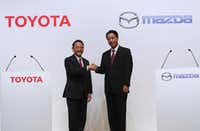 Toyota President Akio Toyoda (left) and Mazda President Masamichi Kogai(Eugene Hoshiko/The Associated Press)