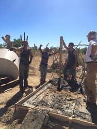 <p>Elijah Hernandez (left) and Benjamin Hernandez (second from right) work in a barrio near Cabo San Lucas, Mexico, while on a religious mission trip in November 2014. Benjamin flew home to Dallas after seven days, leaving Elijah behind. He vanished in January 2015. (Courtesy of Teresa Hernandez)</p>