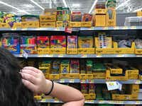 Morning News writer Lauren Fox hunts for school supplies at Walmart in Dallas on Wednesday, Aug. 10.(Ryan Michalesko/Staff Photographer)
