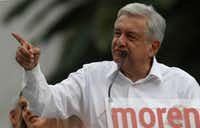 "Mexican presidential hopeful Andres Manuel Lopez Obrador, leader of the National Regeneration Movement, MORENA, speaks during a rally at the Revolution Monument in Mexico City. Mexico's latest political scandal involves Lopez Obrador, when a slickly-produced videotape, complete with edits, ominous theme music and subtitles, was leaked, showing a Lopez Obrador associate receiving wads of cash allegedly given to her by ""businessmen"" and intended for Lopez Obrador himself. The video, according to some, smacked of old-style Institutional Revolution Party dirty tactics.(Christian Palma/AP)"