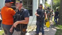 """Unite the Right protesters stand outside Serhat Peker's restaurant in Charlottesville, Va. on Saturday, August 12.(<p><span style=""""font-size: 1em; background-color: transparent;"""">Serhat Peker</span><br></p><p></p>/Contributor)"""
