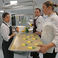 Elizabeth De Leon, Kelcie Feldotto and Andrea Meyer make macarons at Bisous Bisous industrial kitchen on N. Stemmons Freeway.(Louis DeLuca/Staff Photographer)