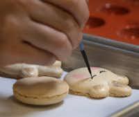 "<p><span style=""font-size: 1em; background-color: transparent;"">Pastry sous chef Elizabeth De Leon's artful unicorns are vanilla flavored and hand painted with edible paints.</span></p>(Louis DeLuca/Staff Photographer)"