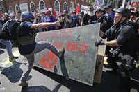 "White nationalists, neo-Nazis and members of the ""alt-right"" clash with counter-protesters as they enter Lee Park during the ""Unite the Right"" rally August 12, 2017 in Charlottesville, Va. After clashes with anti-fascist protesters and police the rally was declared an unlawful gathering and people were forced out of Lee Park, where a statue of Confederate General Robert E. Lee is slated to be removed.(Chip Somodevilla/Getty Images)"