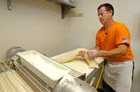 Head baker Chris Cutshall works on dough to make apple cinnamon walnut bread at Empire Bread Company in Dallas.(Jae S. Lee/Staff Photographer)