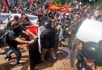 White supremacists clash with counterdemonstrators at the entrance to Lee Park in Charlottesville, Va.(Steve Helber/The Associated Press)