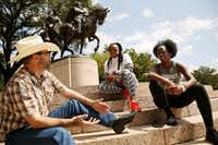 From left:  Daniel Shipman, Adria Green and Crystal Sentell, all of Dallas, have a conversation about race, racism and Civil War history near a statue of Confederate Gen. Robert E. Lee at Lee Park in the Oak Lawn neighborhood of Dallas on Wednesday.(Andy Jacobsohn/Staff Photographer)