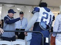 Dallas Cowboys owner and general manager Jerry Jones introduces Dallas Cowboys running back Ezekiel Elliott (21) to his guests after the afternoon practice at training camp in Oxnard, Calif. on Aug. 16.(Vernon Bryant/Staff Photographer)