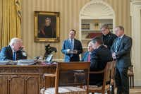 <p>In January, President Donald Trump speaks on the phone with Russian President Vladimir Putin. He is accompanied by (from left) Chief of Staff Reince Priebus, Vice President Mike Pence, National Security Adviser Michael Flynn, Senior Adviser Steve Bannon, and White House press secretary Sean Spicer. Of those in the photo, only the president and vice president remain.</p>(Andrew Harnik/The Associated Press)