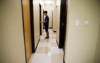 Erik Jimenez walks back to his dorm alone after his parents helped him move in.(Rose Baca/Staff Photographer)