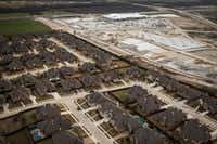 New commercial construction was going up in March near a housing development at U.S. Highway 380 and Preston Road in Frisco, Texas. Denton and Collin counties are projected to boom over the next five years.  (Smiley N. Pool/The Dallas Morning News)