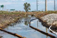 Contaminated water runs toward the Grand Calumet River and Lake Michigan, the source of drinking water for East Chicago, Ind.(Michael M. Santiago/News21)